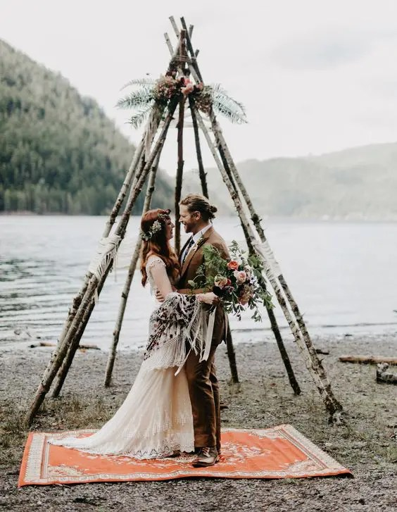 teepee-shaped altar of birch branches and flowers