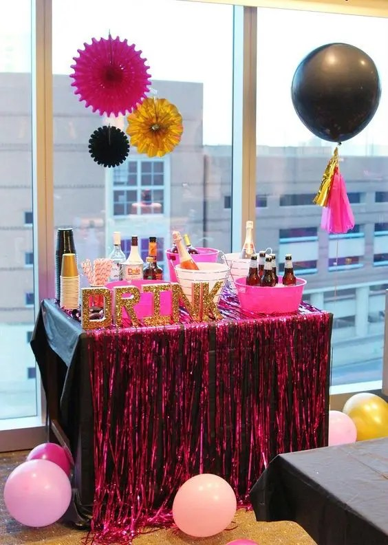 a bold drink bar in black and pink with glitter letters for a fun bachelorette party