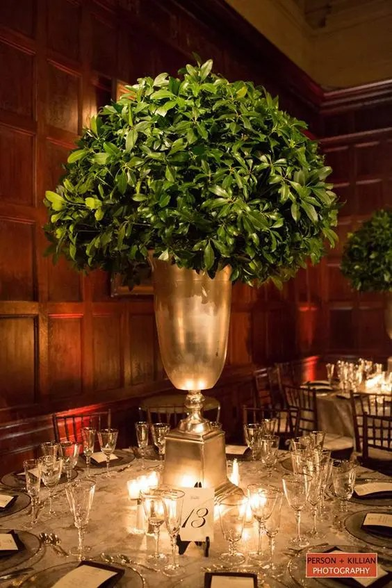 an oversized urn with boxwood for an elegant winter wedding