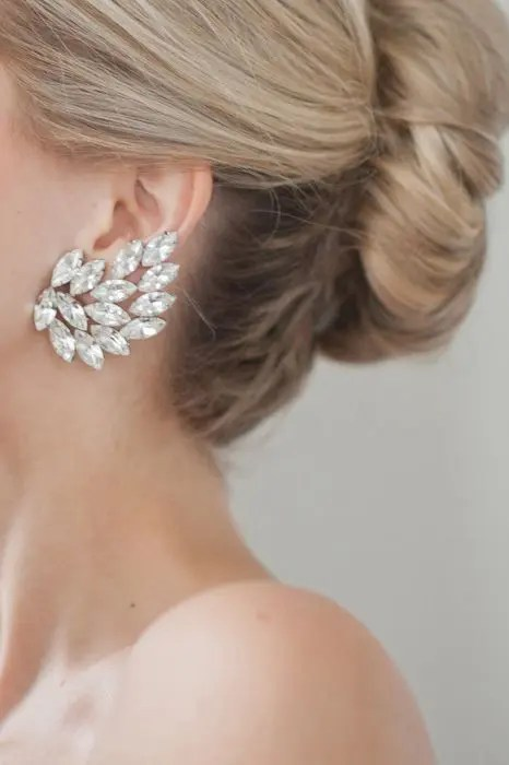 a bold statement earring with large rhinestones shaped as a leaf