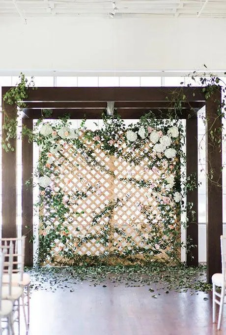 an arbor with a greenery wall will make everyone fell like outdoors in the garden