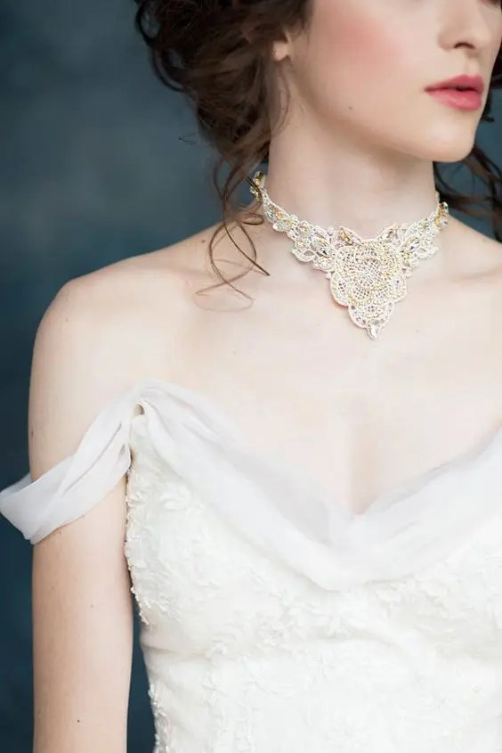unique gold crystal rhinestone necklace will be a fit even for a higger neckline