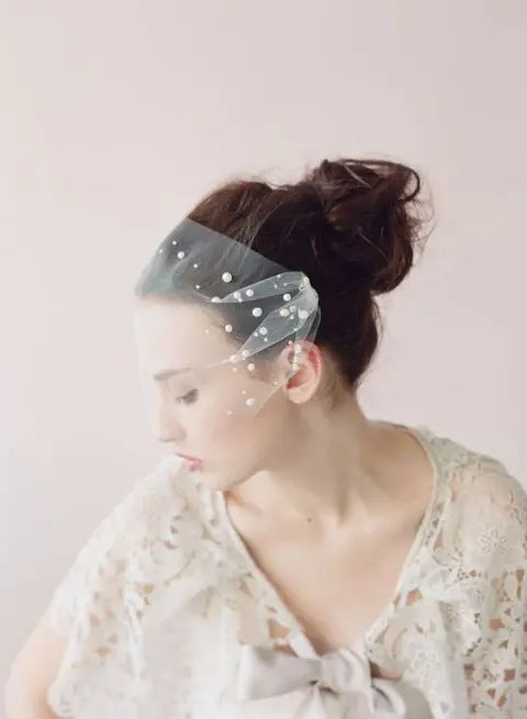 a tulle bandeau veil adorned with large pearls for a cool and modern take on traditional pearls