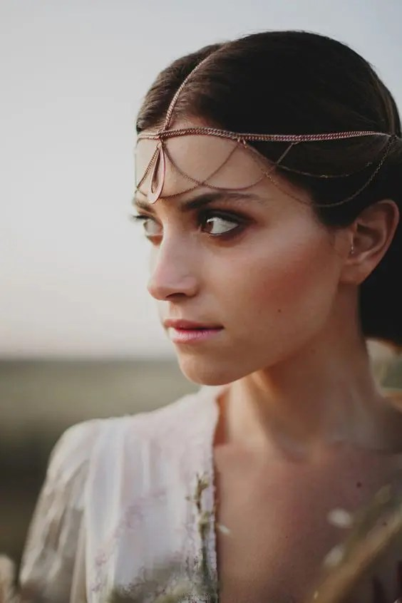 a delicate rose gold chain headpiece with layers and a central pendant looks unique