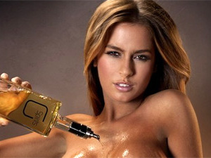 New alcohol poured over model's breasts