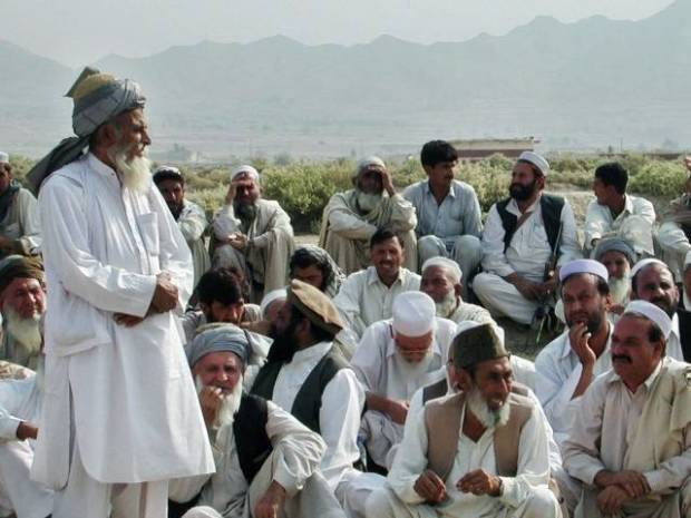 Jirga uses collective responsibility clause to convict tribe in monetary dispute. PHOTO: AFP/FILE