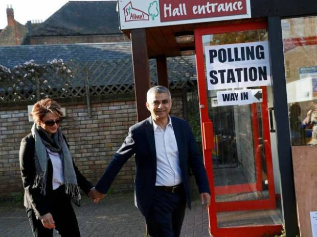 Sadiq Khan and his wife Saadiya leave after casting their votes for the London mayoral elections at a polling station in south London Britain May 5, 2016. PHOTO: REUTERS