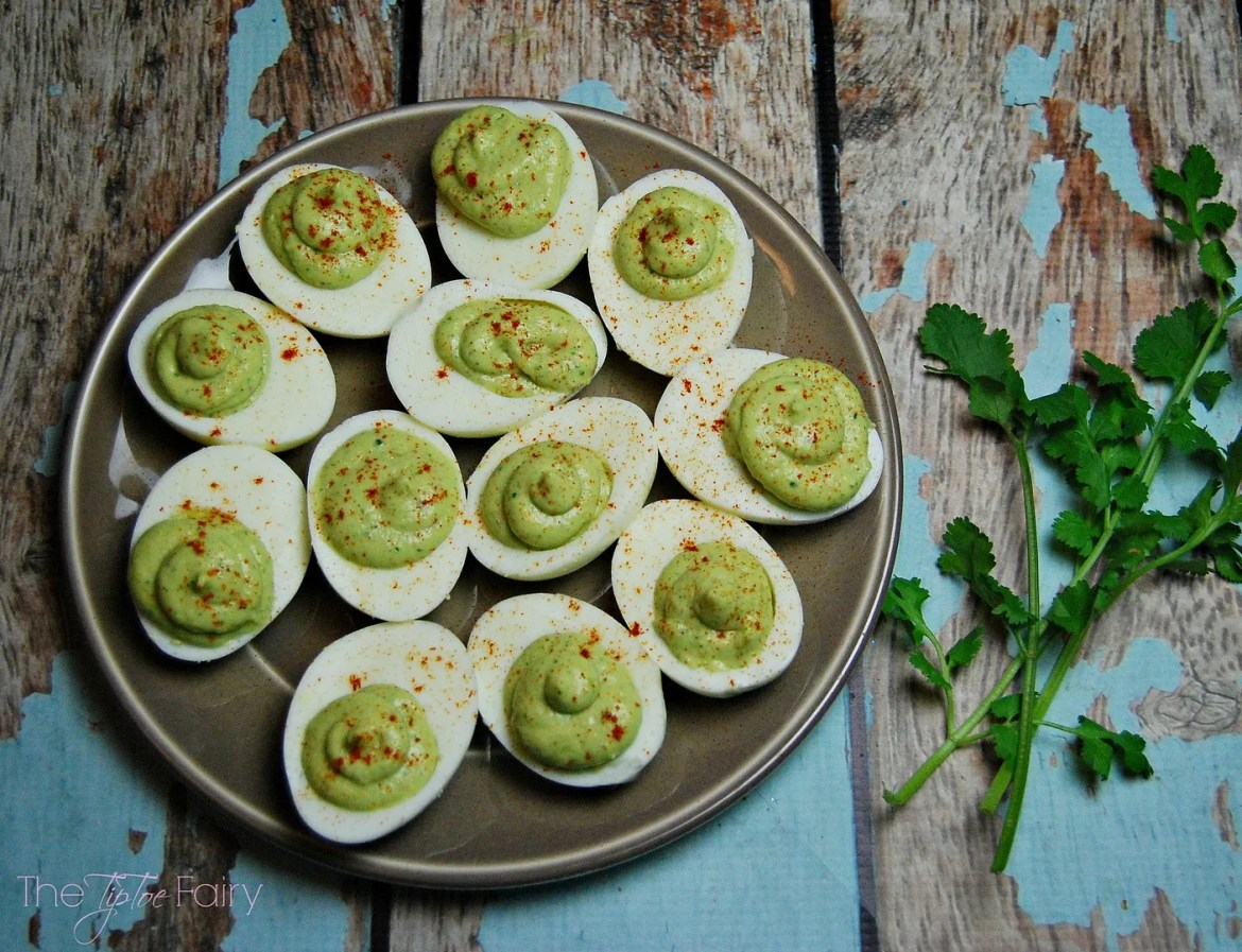 Guacamole Deviled Eggs - an easy finger food for a snack or appetizer for your next holiday party! | The TipToe Fairy #TasteTheMiracle #ad