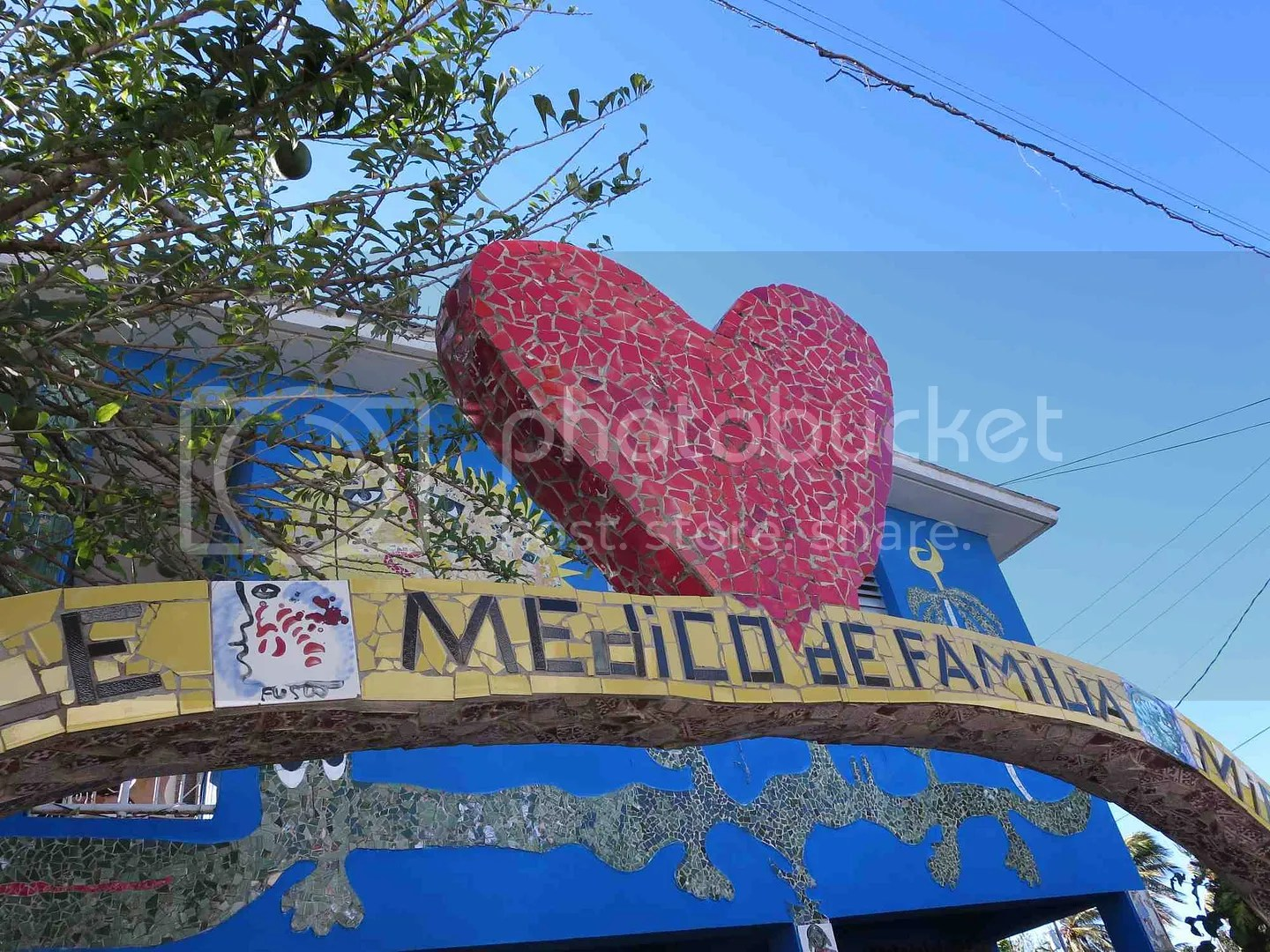 Family doctor with large mosaic heart