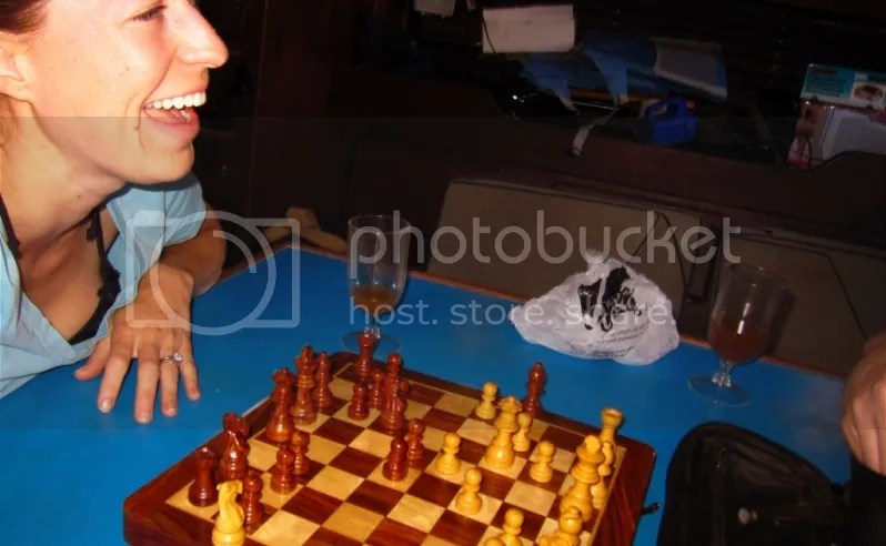 Dani and Tate laughing and playing chess