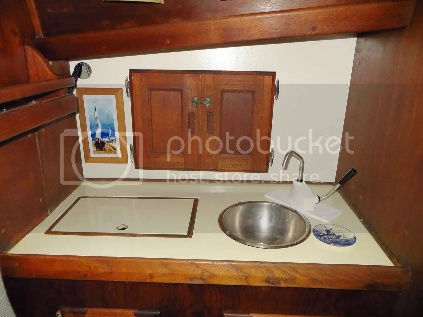 Marine fresh water plumbing and filtration head sink