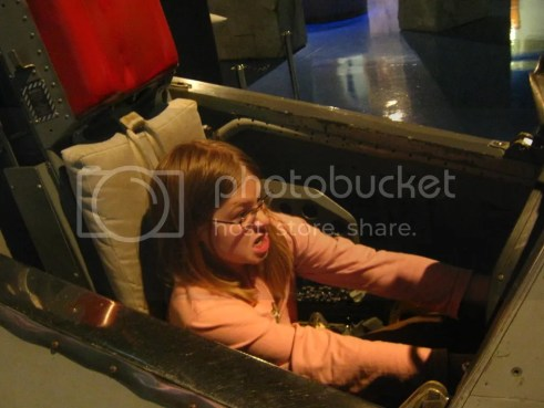 Aly sitting in a flight trainer at the Air Zoo at Kalamazoo