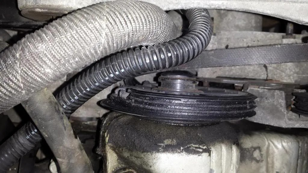 Melted camshaft water pump drive pulley
