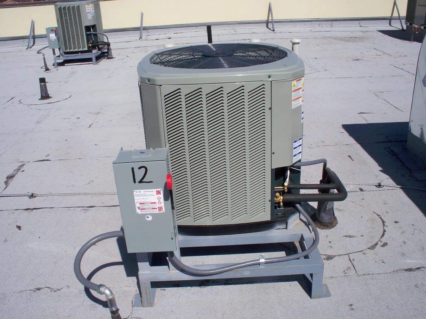 The Right Way To Put A Condenser On A Flat Targravel Roof