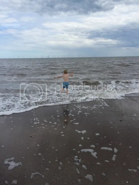 playing in the sea at skegness