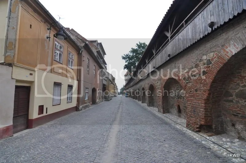 View of the very old brick wall and wooden soldier walkway (on top of the brick) used to fortify the city against invaders.