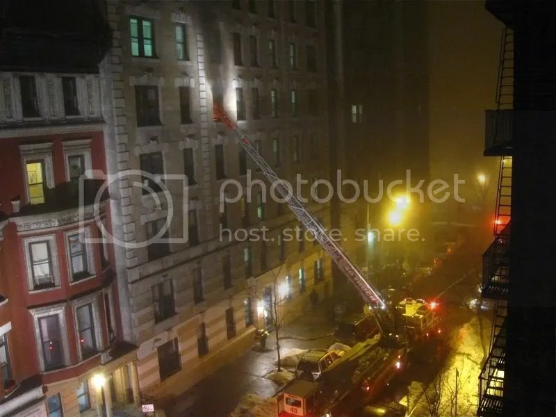 Hook and ladder fire truck outside a fire on 109 St, NYC, Jan 2, 2011