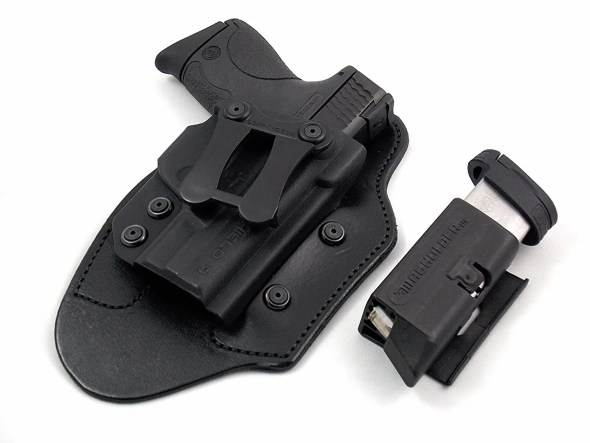 The author's carry gun, holster, and extra mag holder.