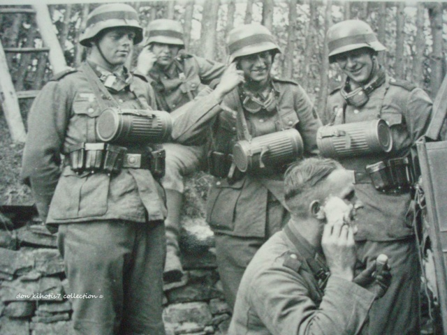 Quick shave in the field Note the bulky gas grenade canisters - field note