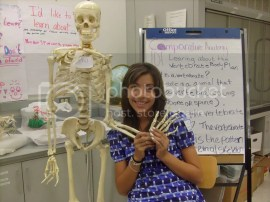 JP team member, Genesis, with a skeleton at the Comparative Anatomy station