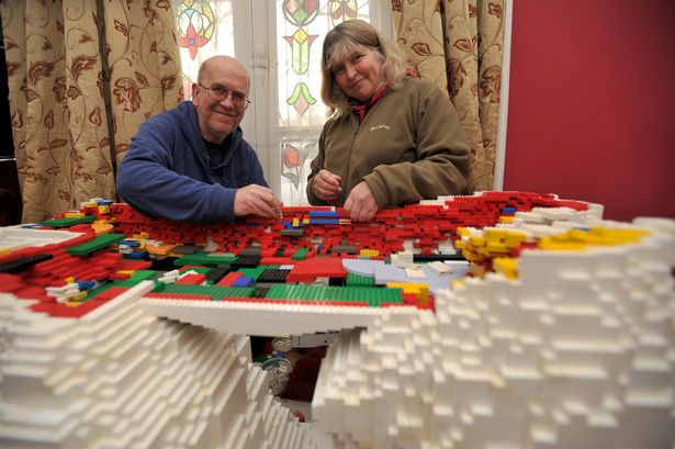 FESTIVE: Michael Addis and Catherine Weightman halfway through building a giant Lego Christmas model of a polar bear