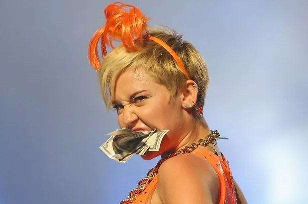 Miley Cyrus Gets Giant Wedgie In Bright Orange Leotard As