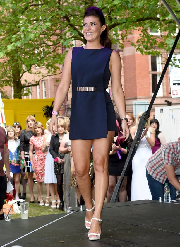 Manchester Tan Kym Marsh Puts On Leggy Display In Short Navy Dress As She