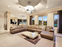 Split-level living room using beige colours with carpet ...