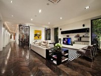 Open plan living room using black colours with hardwood ...