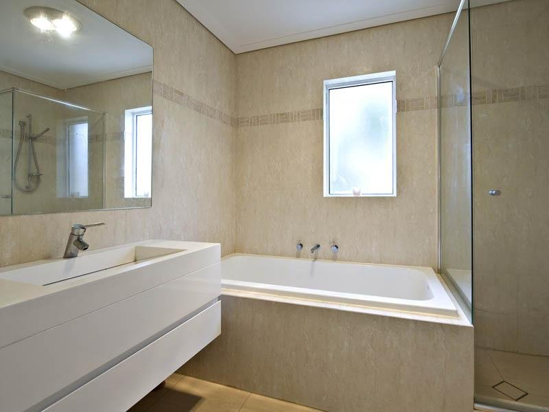 Modern bathroom design with corner bath using marble