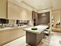 Modern island kitchen design using wood panelling ...