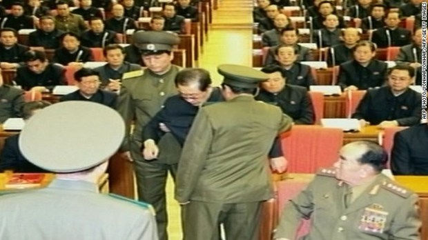 In an image taken from footage shown by North Korea's KCTV and released by South Korea's Yonhap news agency on December 9, 2013, Jang Song-Thaek is reportedly being dragged away from his chair by two police officials during a meeting in Pyongyang. North Korea confirmed on December 9 that the powerful uncle of Kim Jong-Un, the nation's leader, had been removed. New reports from North Korea say that Jang has been executed.