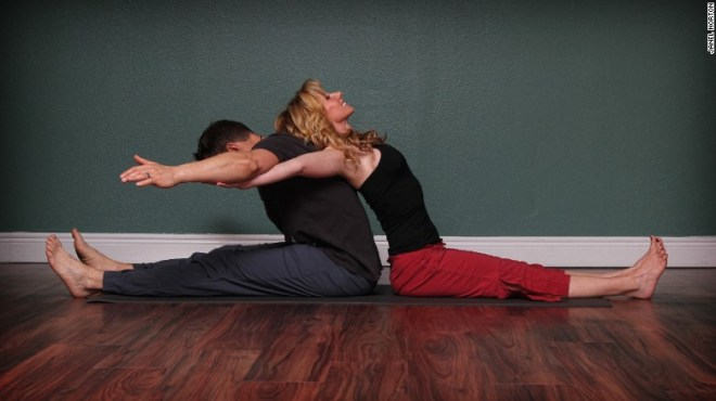 This yoga position lengthens low-back and hamstrings, alternately opens chest and front of shoulders