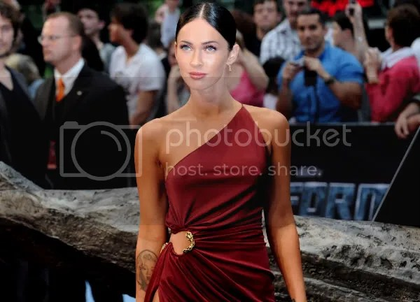 Megan Fox in a one-shoulder dress with side split