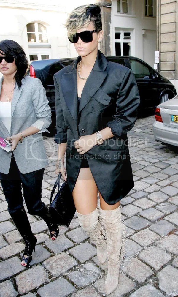 Rihanna in over the knee boots at PFW