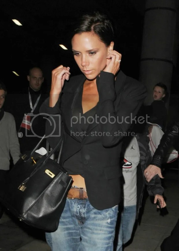 Victoria Beckham leaving Wembley Stadium in jeans and flip-flops