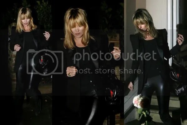 Kate Moss wearing a dinner jacket and latex pants