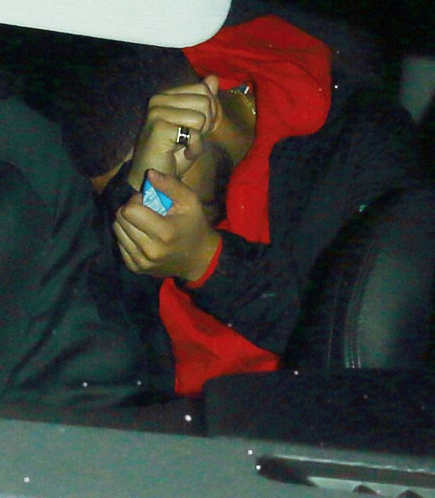 Drake covering his face in the car as he leaves the Nice Guy with Rihanna in West Hollywood, California
