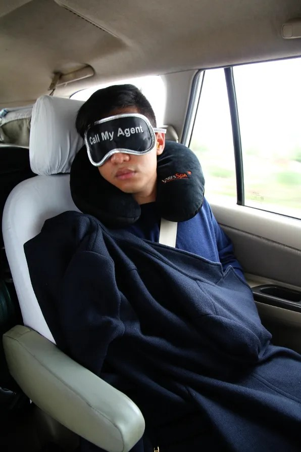 Bryanboy sleeping in the car on the road from Agra to Jaipur