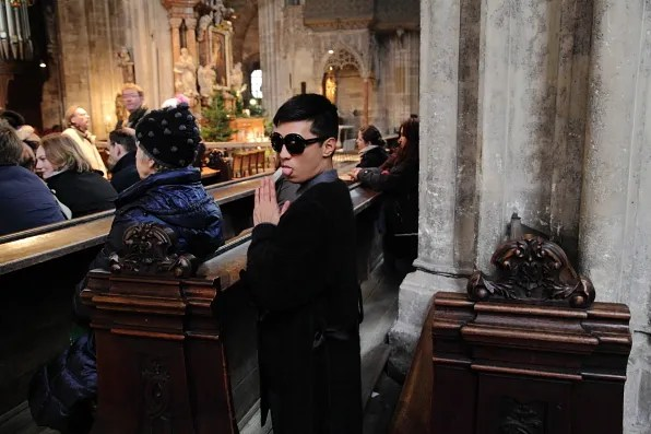 Bryanboy sticking his tongue out while praying at St. Stephen's Cathedral, Vienna