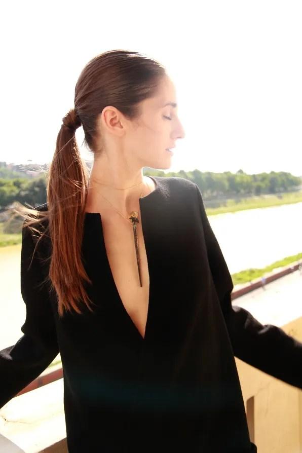 Ania wearing a black Calvin Klein dress