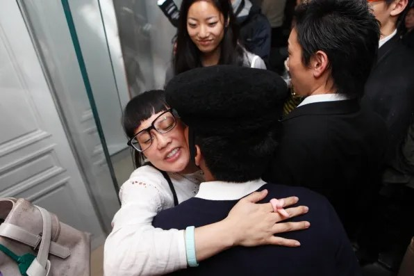 Mai hugging Bryanboy at Christian Dior