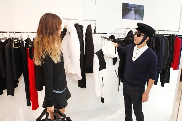 Bryanboy and Rumi looking at Costume National coats