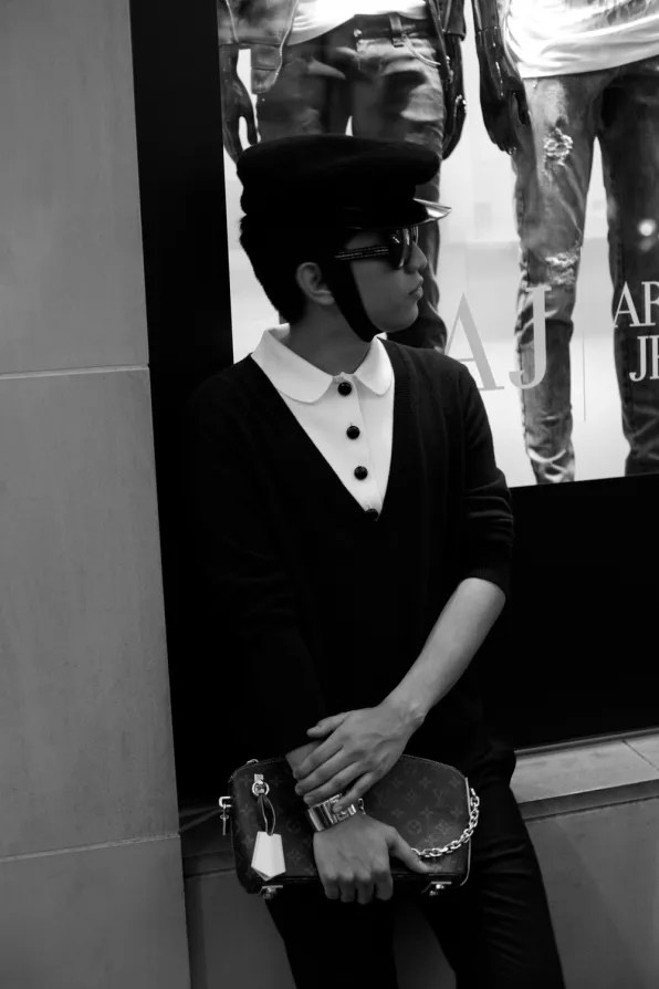Bryanboy standing outside Armani Jeans window in Tokyo