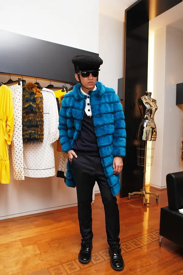 Bryanboy wearing a dyed mink coat from Fendi