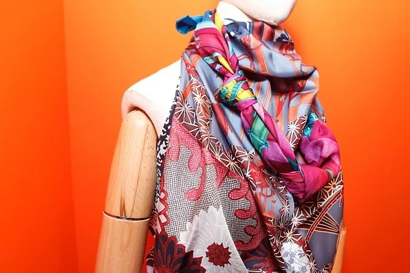 Mannequin wearing draped Hermes silk scarf