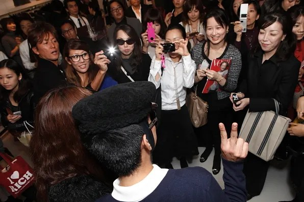 Bryanboy being photographed by his Japanese fans at the Michael Store boutique in Tokyo