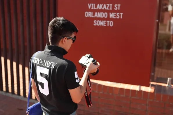 Bryanboy taking photos outside Mandela House