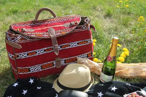 Red Moroccan carpet bag used as picnic basket