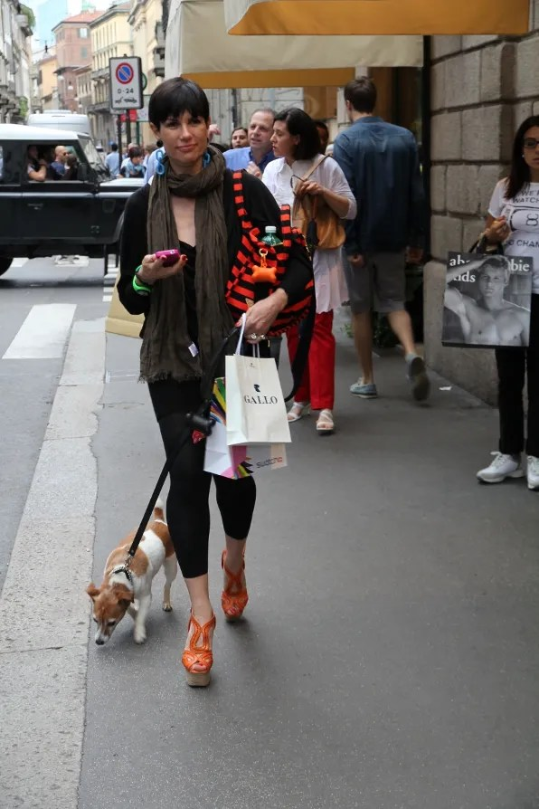 Woman wearing a Prada bag and Prada shoes at Via Montenapoleone, Milan